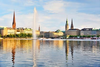 Panoramic view of Binnenalster (Inner Alster Lake) with Jungfernstieg and Rathaus in the background at sunset, Germany